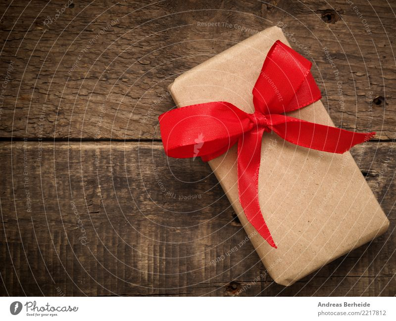 A gift Feasts & Celebrations Valentine's Day Mother's Day Christmas & Advent Birthday Love box red bow ribbon present wood wrapped holiday natural concept card