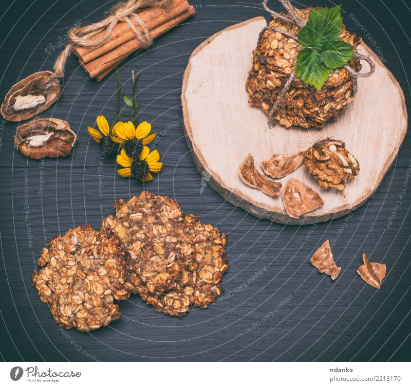 homemade oatmeal cookies Dessert Nutrition Breakfast Lunch Diet Hot Chocolate Table Flower Leaf Wood Eating Delicious Natural Brown Yellow Black Energy