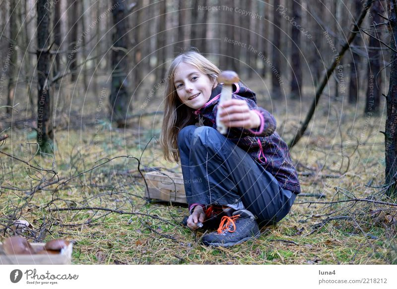 stone mushroom Food Girl 1 Human being 8 - 13 years Child Infancy Nature Autumn Forest Laughter Friendliness Happiness Joie de vivre (Vitality) Mushroom amass