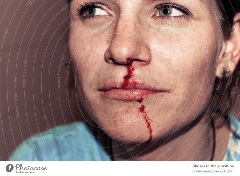 Ouch! Young woman Youth (Young adults) Woman Adults Life Head Nose Lips 1 Human being 18 - 30 years Weather Brunette Red Pain Anger Argument Nose bleed Blood