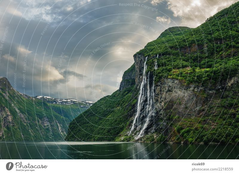 View of the Geirangerfjord in Norway Relaxation Vacation & Travel Tourism Mountain Nature Landscape Water Clouds Tree Rock Fjord Waterfall Tourist Attraction