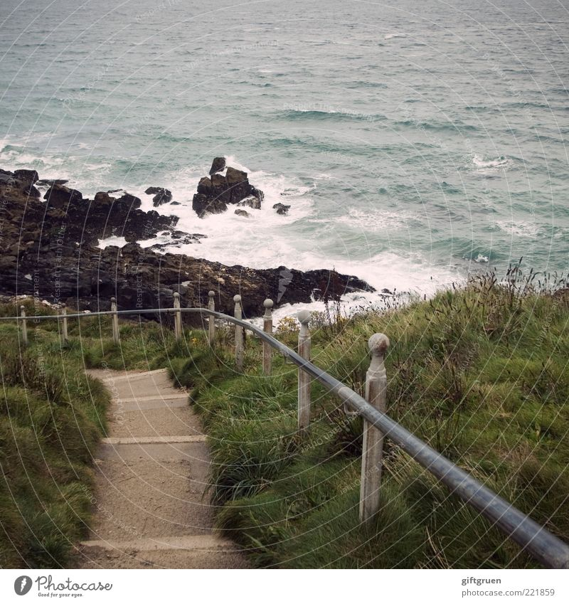 downwards Environment Nature Landscape Elements Water Wind Gale Plant Grass Rock Waves Coast Ocean Island Downward Stairs Banister Curve White crest Surf