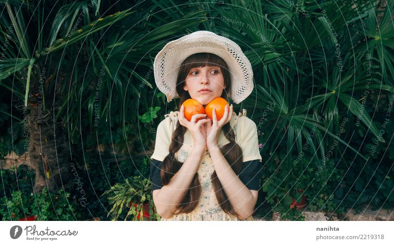 Young woman holding fruit in her hands Human being Nature Youth (Young adults) Plant Summer Healthy Eating Beautiful Green 18 - 30 years Adults Lifestyle Autumn