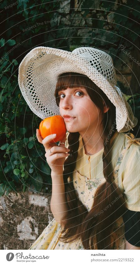 Young and old fashioned woman holding a persimmon Human being Youth (Young adults) Young woman Healthy Eating Beautiful 18 - 30 years Adults Lifestyle Natural