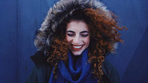 Young redhead woman smiling and wearing winter clothes Human being Youth (Young adults) Young woman Beautiful Joy Winter 18 - 30 years Adults Life Lifestyle