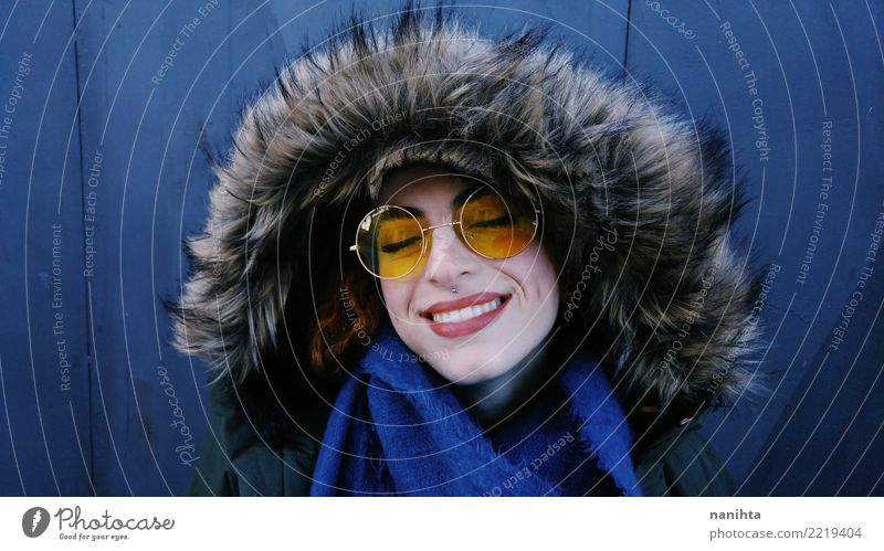 Young woman wearing a fur coat and yellow glasses Human being Youth (Young adults) Blue Beautiful Joy Winter 18 - 30 years Black Face Adults Warmth Yellow