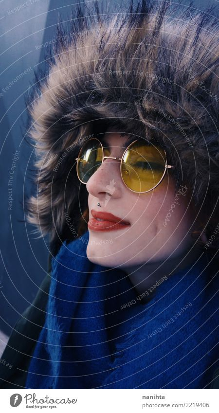 Beautiful young woman wearing winter clothes Human being Youth (Young adults) Young woman Blue Red 18 - 30 years Face Adults Yellow Lifestyle Cold Feminine