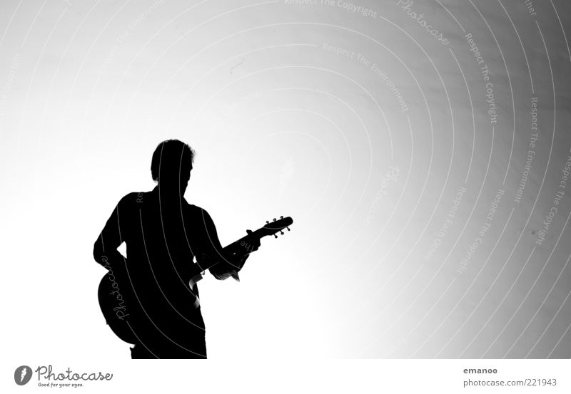 Silhouette 5 Lifestyle Leisure and hobbies Playing Music Human being Masculine 1 Art Culture Event Shows Singer Musician Guitar Stand Modern Black White Moody