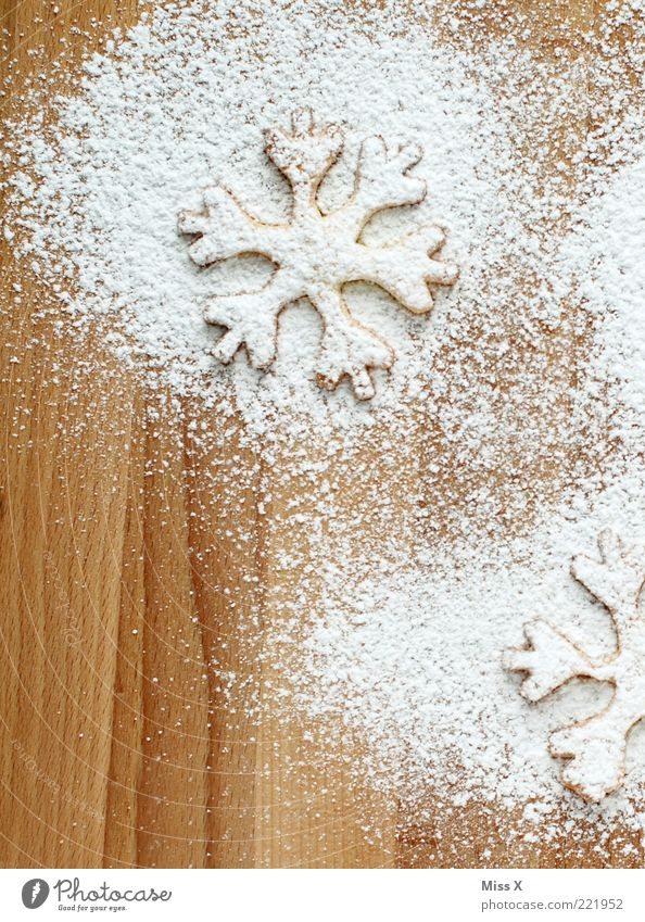 White Christmas & Advent Nutrition Food Sweet Cooking & Baking Delicious Wooden board Baked goods Sugar Cookie Dough Cookie Snowflake Christmas decoration Pierce