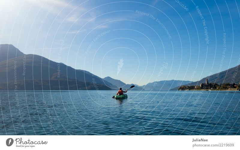 Canoeing on Lake Como Italy Water Calm Watercraft Paddling Driving Human being Mountain Blue Vacation & Travel Adventure Exterior shot Sports Kayak Rowing