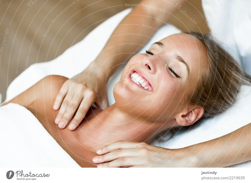 Young blond woman receiving a head massage in a spa center Woman Human being Youth (Young adults) Young woman Beautiful White Hand Relaxation Joy 18 - 30 years