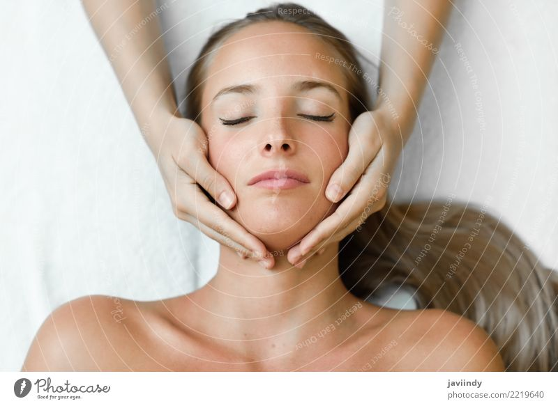 Young blond woman receiving a head massage in a spa center Woman Human being Youth (Young adults) Young woman Beautiful White Hand Relaxation 18 - 30 years Face