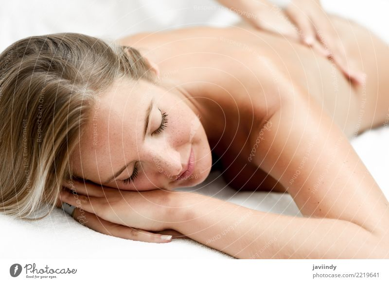 Young blond woman having massage in the spa salon. Woman Human being Youth (Young adults) Young woman Beautiful White Hand Relaxation 18 - 30 years Face Adults