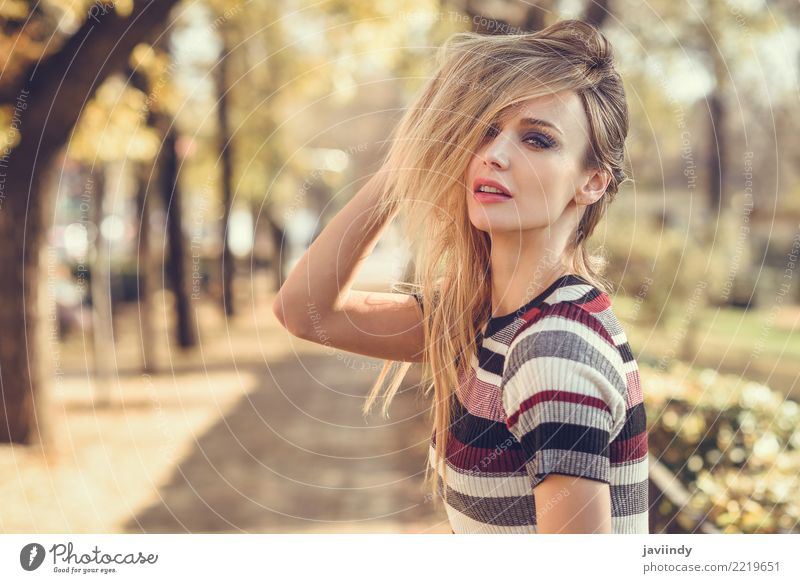 Young blonde woman moving her hair in the street Woman Human being Youth (Young adults) Young woman Beautiful White 18 - 30 years Adults Street Lifestyle Autumn