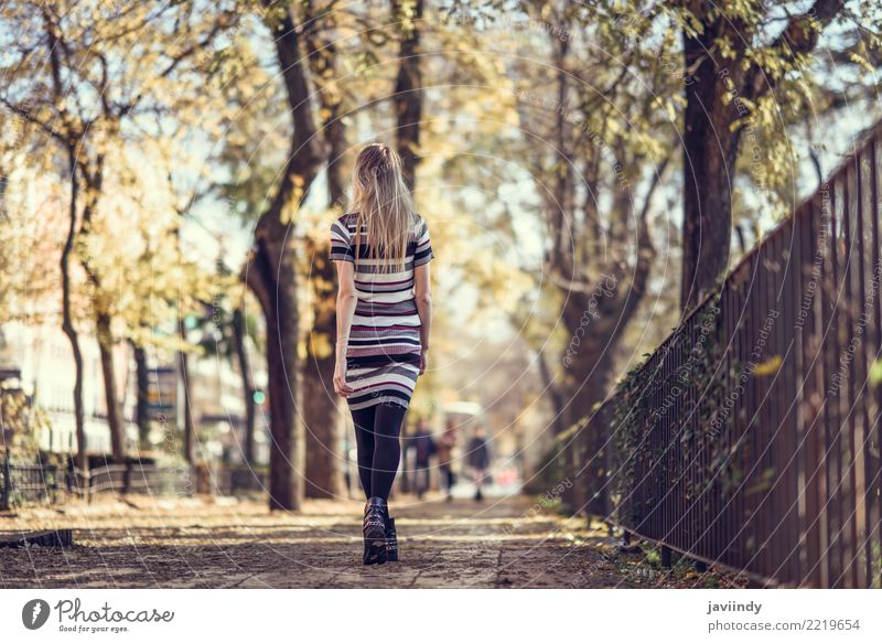Rear view of young blonde woman walking in the street. Woman Human being Youth (Young adults) Young woman Beautiful White 18 - 30 years Adults Street Lifestyle