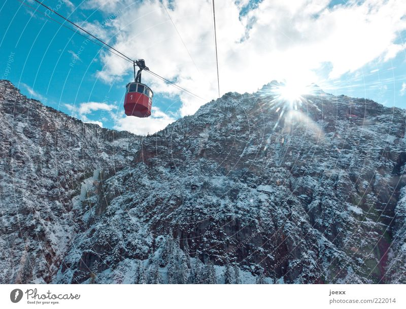 vintage car Sky Clouds Sun Sunlight Winter Beautiful weather Snow Alps Mountain Peak Cable car Old Esthetic Gigantic Large Historic Tall Cold Blue Red White
