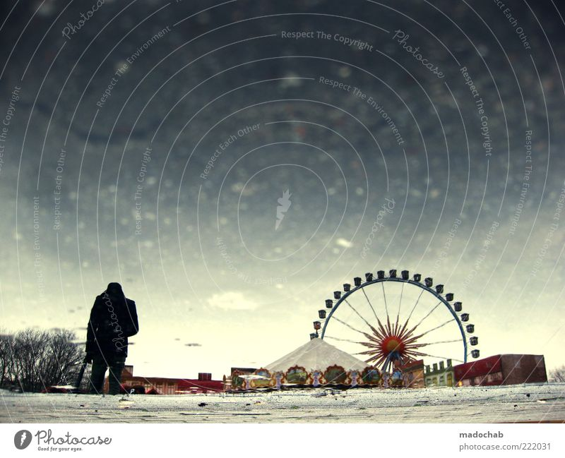 Silhouette of a man in lockdown in front of the Ferris wheel - melancholy Lifestyle Entertainment Fairs & Carnivals Masculine Man Adults Environment Water