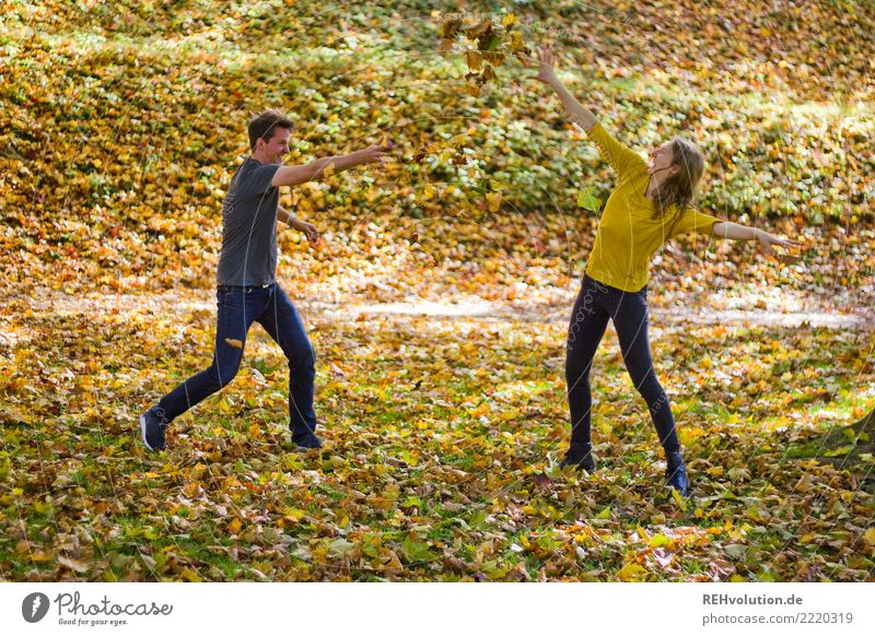 Couple makes a leaf fight in autumn Young man Young woman Adults Woman Man Partner 18 - 30 years Environment Nature Autumn Beautiful weather naturally Funny