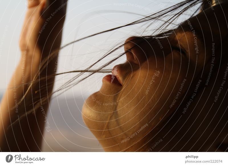 Gone. Human being Young woman Youth (Young adults) Skin Face Beautiful weather Wind To enjoy Colour photo Close-up Day Profile Closed eyes Gust of wind