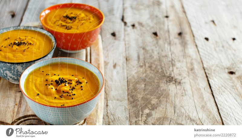 Fresh pumpkin soup in three bowls on a wooden table Colour Yellow Autumn Table Delicious Vegetable Harvest Bowl Cooking Meal Vegetarian diet Hallowe'en Pumpkin