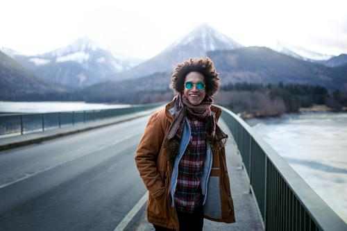 young man is having great time with mountains view Christmas & Advent Winter Lifestyle Snow Clothing Photography Direction Sunglasses Traveling Hipster Shot