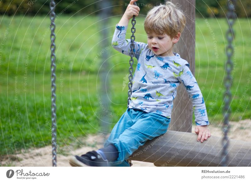Child on the playground Leisure and hobbies Human being Boy (child) 1 3 - 8 years Infancy Nature Grass Meadow Playground Movement Playing Authentic Small