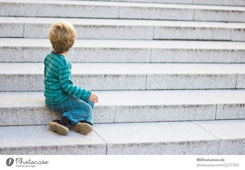 Child sitting on a staircase Human being Toddler Boy (child) Infancy 1 1 - 3 years Town Stairs Sweater Sneakers Observe Sit Wait Authentic Small naturally Gray