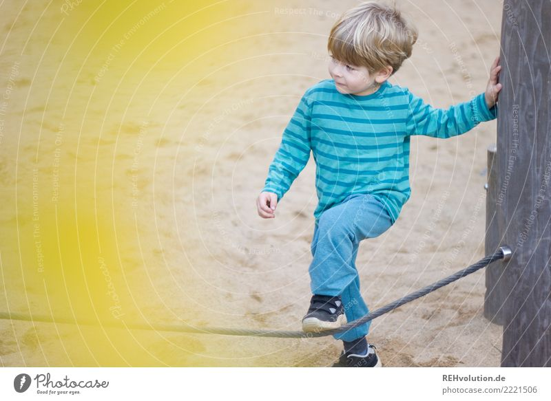 Child on the playground Leisure and hobbies Playing Boy (child) 1 Human being 3 - 8 years Infancy Playground Sand Movement Authentic Small Yellow turquoise Joy