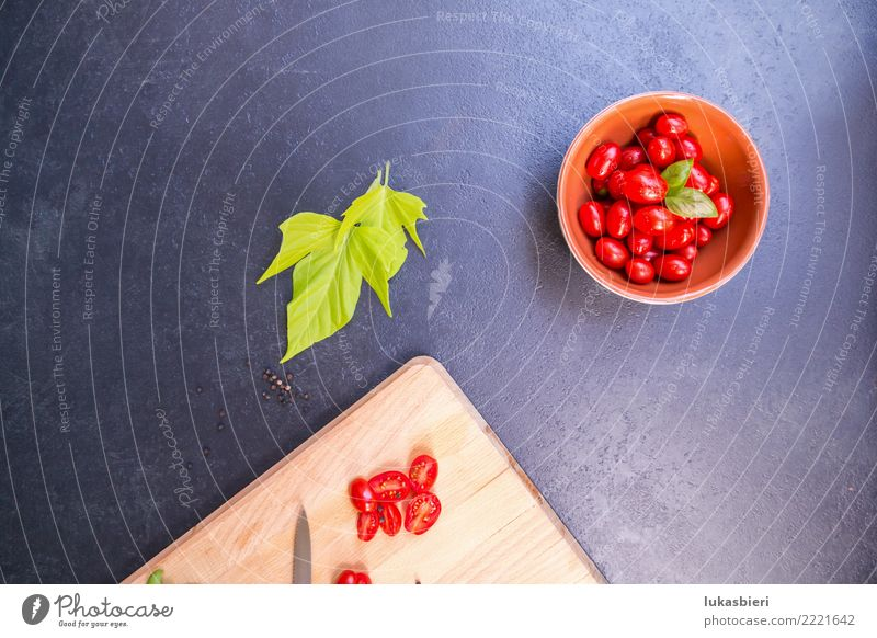 Cherry tomatoes with chopping board Vegetable Herbs and spices Aperitif Bowl Tomato cherry Near Basil cutting board Sliced Fresh Leaf Summer Spring Kitchen
