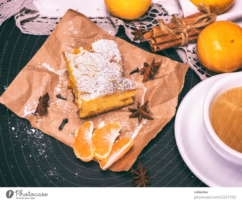 piece of mandarin cake Food Fruit Cake Dessert Nutrition Vegetarian diet Beverage Coffee Mug Table Wood Eating Delicious Natural Brown Yellow Black White