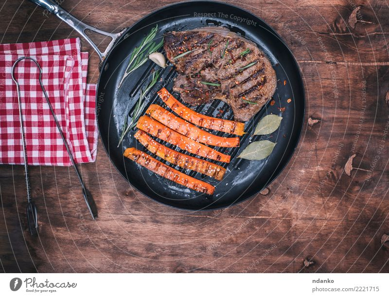 fried beef stack Meat Vegetable Herbs and spices Lunch Pan Table Wood Eating Hot Delicious Brown Red Black Carrot Sesame tongs Napkin Rosemary Steak Cooking BBQ