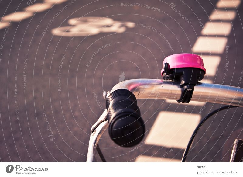 Street Pink Bicycle Signs and labeling Transport Door handle Road traffic Means of transport Chrome Signal Bicycle bell Brakes Lane markings Bicycle handlebars Cycle path Safety