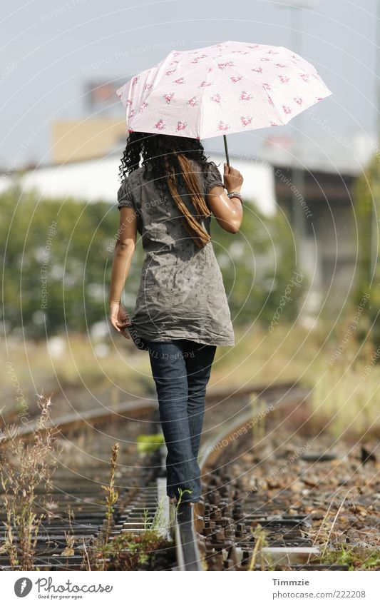 Youth (Young adults) Feminine Happy Fashion Adults Contentment Wet Back Simple Natural Umbrella Railroad tracks Serene Joie de vivre (Vitality) Brunette