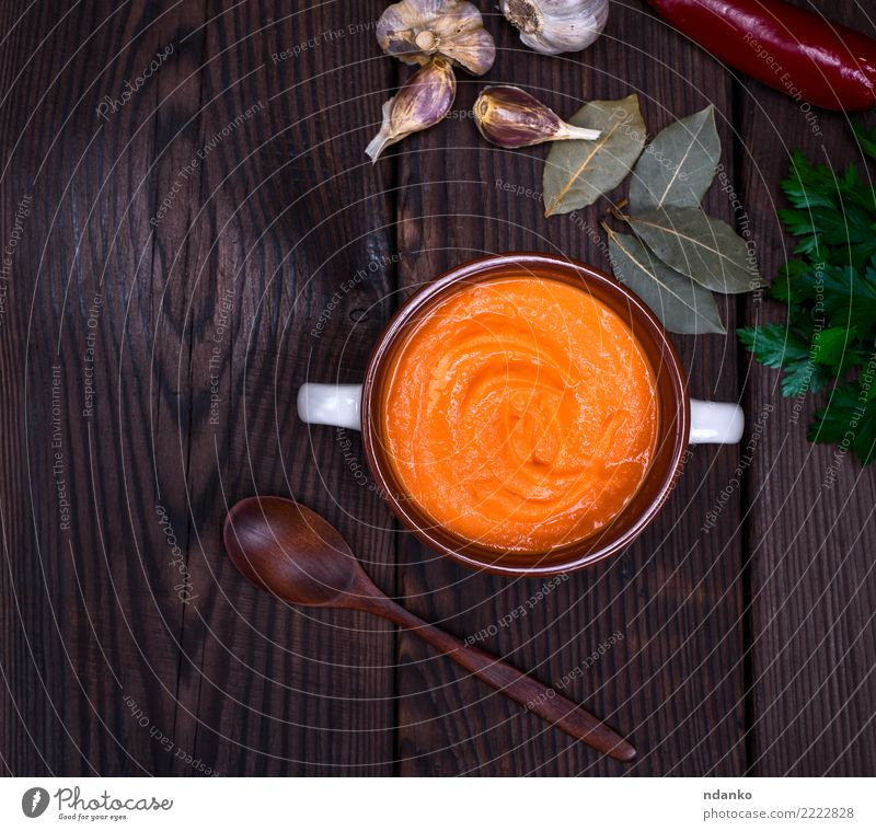 fresh pumpkin soup Vegetable Soup Stew Herbs and spices Eating Lunch Dinner Organic produce Vegetarian diet Diet Bowl Spoon Decoration Table Hallowe'en Nature