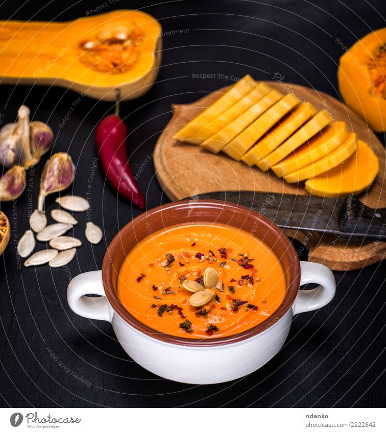 pumpkin soup in a ceramic plate Vegetable Soup Stew Herbs and spices Nutrition Eating Lunch Dinner Vegetarian diet Diet Plate Table Hallowe'en Nature Wood Fresh