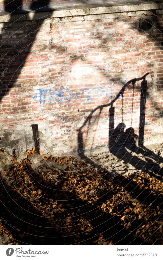 Human being Child Leaf Dark Wall (building) Playing Wall (barrier) Family & Relations Graffiti Bright Adults Mother Leisure and hobbies Infancy Swing