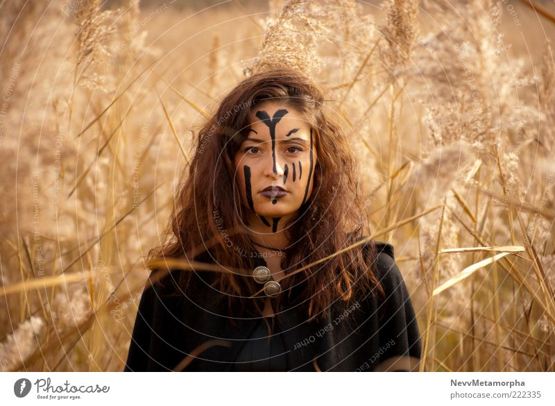 Human being Youth (Young adults) Plant Adults Loneliness Face Eyes Feminine Dark Head Grass Hair and hairstyles Garden Art Brown Power