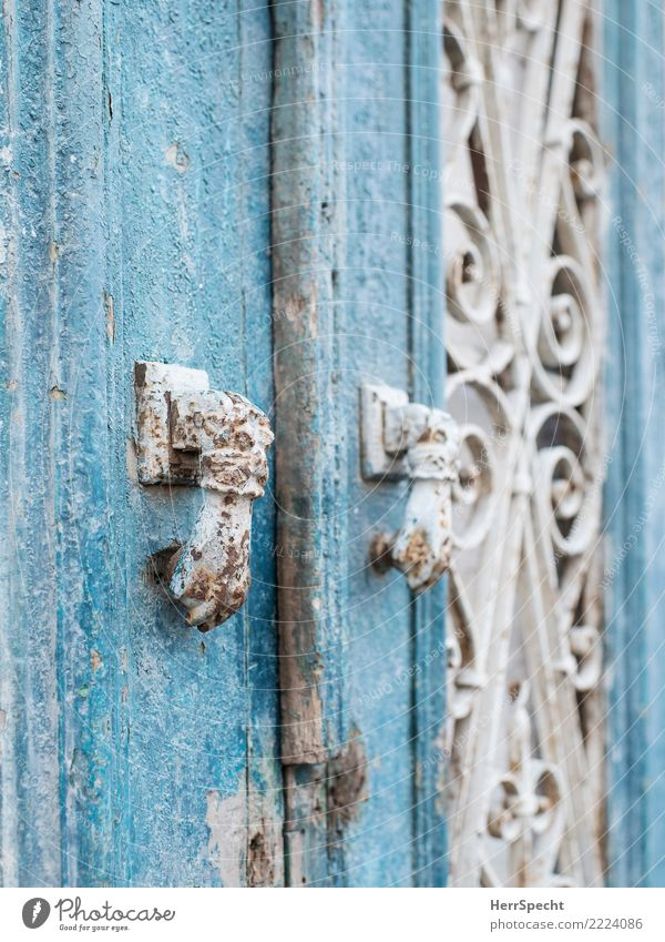 double-knob Door Old Exceptional Historic Retro Turquoise White Knocker Rust signs of ageing Patina Wooden door Detail Close-up Colour photo Exterior shot