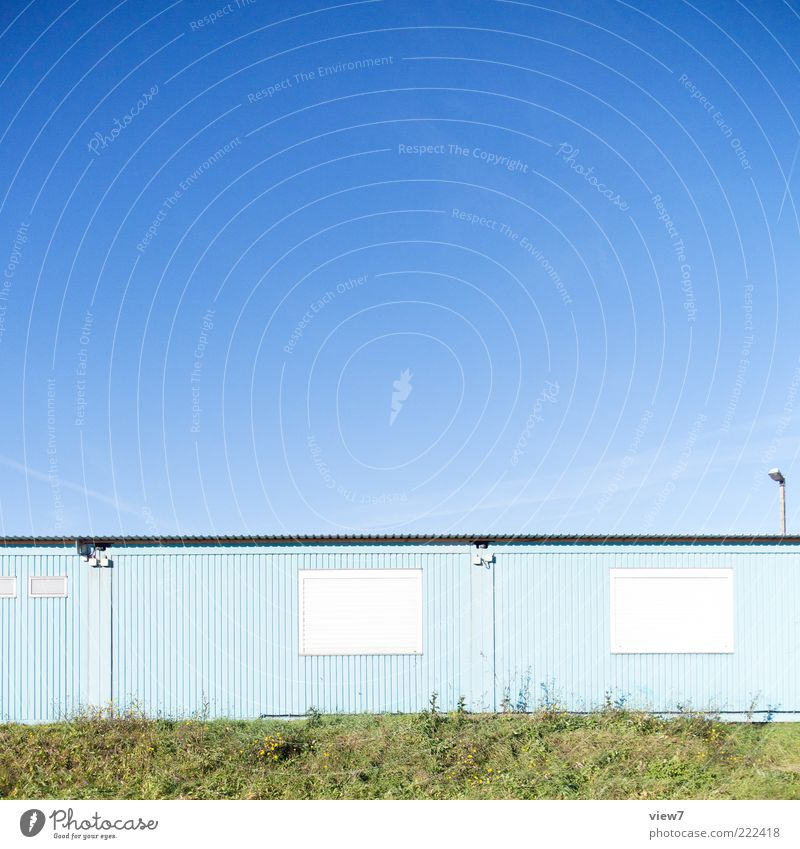 light blue Sky Cloudless sky Beautiful weather Industrial plant Manmade structures Wall (barrier) Wall (building) Facade Metal Line Bright Modern New Gloomy