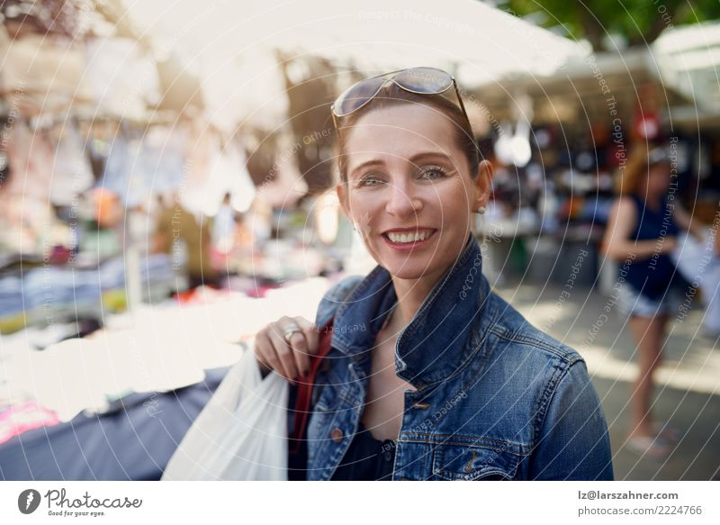 Happy woman shopping at an outdoor market Woman Human being Vacation & Travel Summer Face Adults Street Warmth Tourism Leisure and hobbies Smiling Gift Clothing