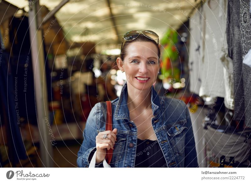 Happy woman shopping at an outdoor market Shopping Face Leisure and hobbies Vacation & Travel Tourism Summer Woman Adults 1 Human being 30 - 45 years Warmth