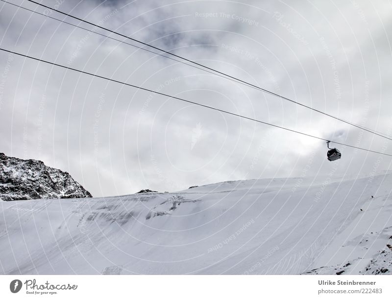 season start Exterior shot Mountain Alps Rettenbachferner Slope Glacier Snow Ice Cold Chair lift Winter Austria Sölden Ötz Valley Rock Steel cable Cable car