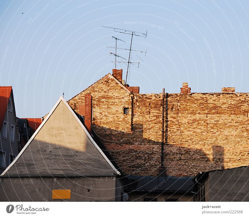 Wittenberg No.444 Cloudless sky Old town Facade Chimney Antenna Fire wall Brick Gloomy Brick wall Gable Ravages of time Shadow play Neutral Background Sunlight