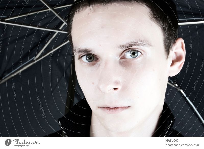 Portrait of a young dark-haired man Human being Man Face Black Loneliness Style Adults Weather Lifestyle Modern Model Hair Guy Earnest