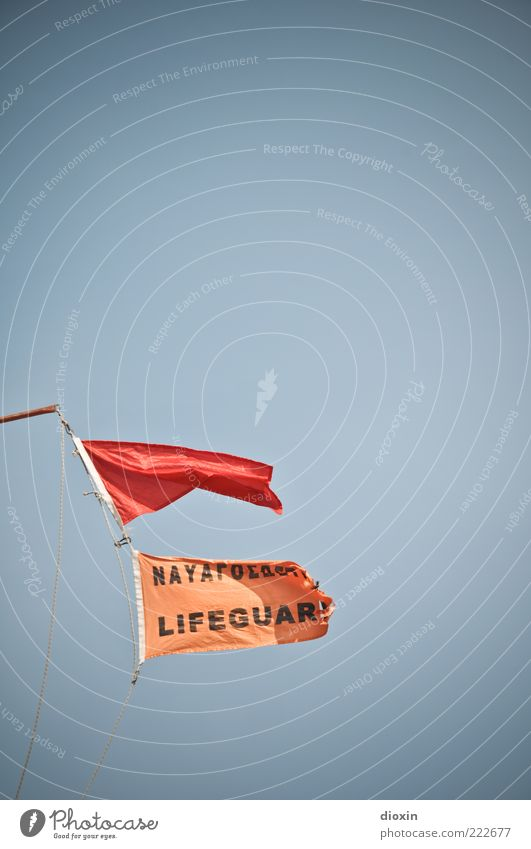 LIFEGUAR(D) Sky Cloudless sky Wind Gale Flag Red Lifeguard Rescue Warning label Blow Judder Bans Danger of Life Colour photo Exterior shot Deserted