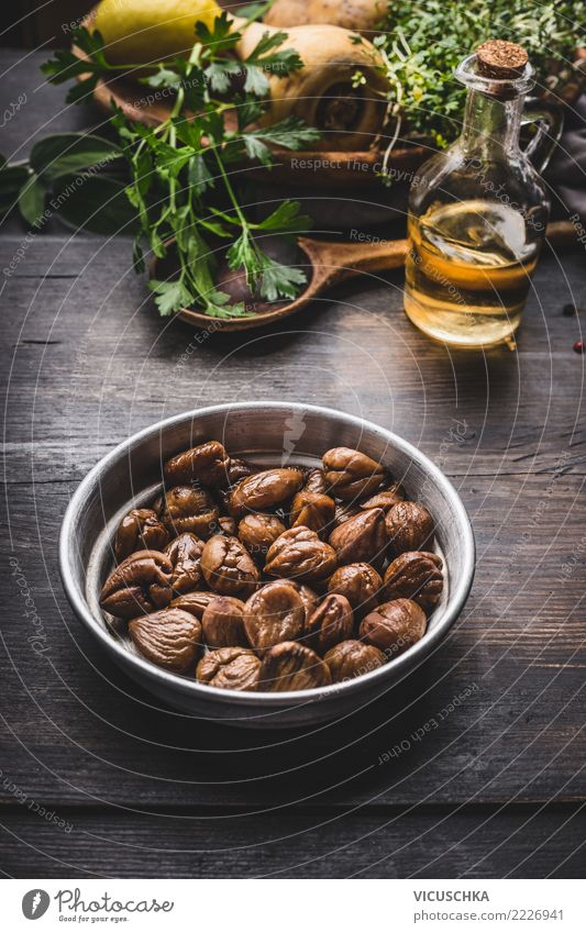 Fried chestnuts in bowl on the kitchen table Food Vegetable Herbs and spices Cooking oil Nutrition Lunch Dinner Organic produce Vegetarian diet Diet Crockery