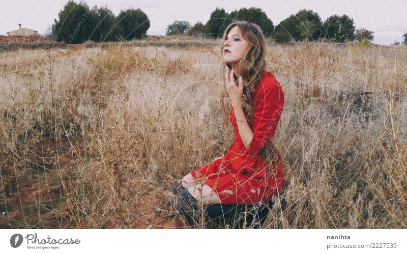 Young blonde woman wearing a red dress is waiting in a field Human being Nature Vacation & Travel Youth (Young adults) Young woman Summer Beautiful Landscape
