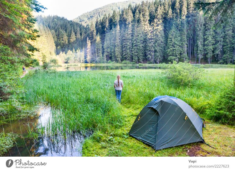 Young woman near green tent and forest lake Woman Human being Sky Nature Vacation & Travel Youth (Young adults) Plant Blue Summer Beautiful Green Water White