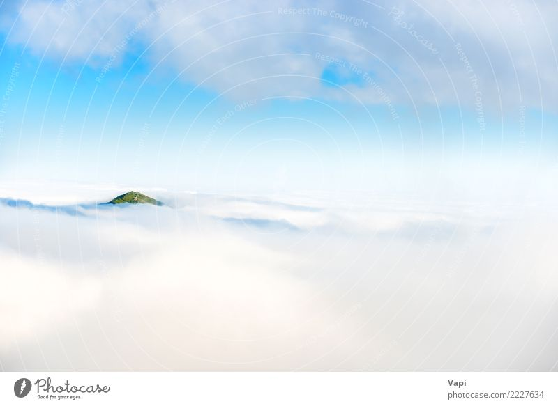 Green mountain peak in clouds Sky Nature Vacation & Travel Blue Summer Beautiful White Landscape Ocean Clouds Mountain Natural Horizon Fog Vantage point