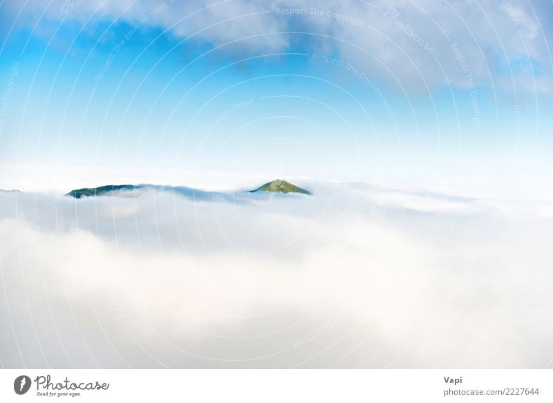 Green mountain peak in clouds Sky Nature Vacation & Travel Blue Summer Beautiful White Landscape Ocean Clouds Mountain Natural Grass Horizon Fog